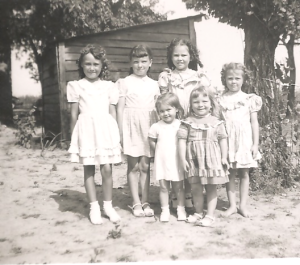 Some of the dresses here are probably from flour sack material. I'm the barefoot one of the bunch.
